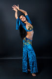 Beautiful slim sexy woman belly dancer. With long glossy hair Stock Images