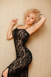 Beautiful slim sexy young blond woman with curly Royalty Free Stock Photography