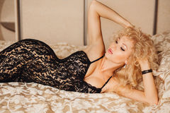 Beautiful slim sexy young blond woman  curly hair Stock Images