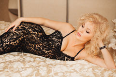 Beautiful slim sexy young blond woman  curly hair Royalty Free Stock Photography