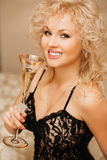 Beautiful slim sexy young blond woman  curly hair Royalty Free Stock Photo
