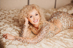 Beautiful slim sexy young blond woman with curly Royalty Free Stock Photo