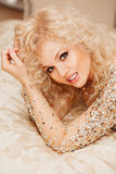 Beautiful slim sexy young blond woman with curly Stock Images
