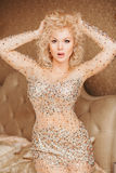 Beautiful slim sexy young blond woman with curly Royalty Free Stock Images