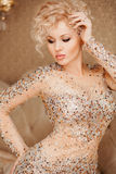 Beautiful slim sexy young blond woman with curly Royalty Free Stock Photos