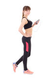 Beautiful slim sporty woman listening music with phone isolated Stock Image
