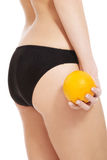 Beautiful slim and supple female buttocks with ora. Nge. Isolated on white Stock Photo