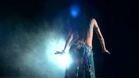 Beautiful slim woman belly dancer dancing, on stock video footage