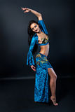 Beautiful slim woman belly dancer. With long glossy hair Stock Image