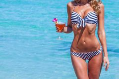 Woman in bikini with cocktail Royalty Free Stock Image