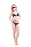 Beautiful slim woman in bikini with towel over white Stock Photo