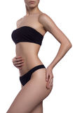 Beautiful slim woman body with tan isolated on white background Royalty Free Stock Photo