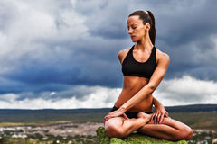 Beautiful slim woman do yoga twist pose Royalty Free Stock Photo