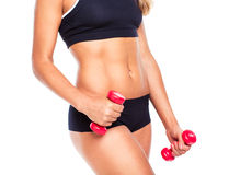 Beautiful slim woman with dumbbells, isolated on white Stock Photos