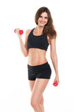 Beautiful slim woman with dumbbells on white Royalty Free Stock Image