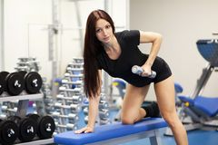 Beautiful slim woman in a gym Stock Photo