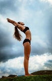 Beautiful slim woman makes yoga exercise Stock Images