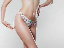 Beautiful slim woman`s body. Perfect slim toned young body Stock Photo