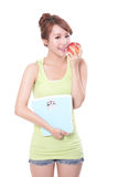Beautiful slim woman with scales and apple Stock Image