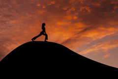 Beautiful slim woman silhouette practices yoga Stock Image