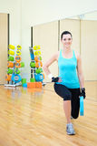Beautiful slim woman working out in modern gym Royalty Free Stock Photos