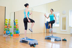 Beautiful slim woman working out with stepper in gym Royalty Free Stock Image
