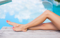 Beautiful slim women legs by the swimming pool Royalty Free Stock Photo