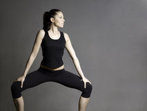 Beautiful slim young fitness brunette. Stock Photography