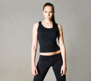 Beautiful slim young fitness brunette. Royalty Free Stock Image