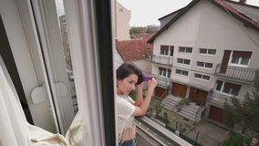 Beautiful slim young woman in balcony stock video