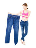beautiful slim young woman with big jeans Royalty Free Stock Images
