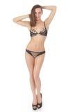 Beautiful slim young woman in black underwear Stock Image