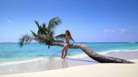 Beautiful slim young woman enjoying vacation on a tropical beach. Maldives stock footage