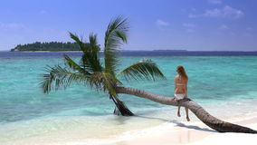 Beautiful slim young woman enjoying vacation on a tropical beach. Slow motion. Maldives stock video footage