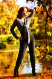Beautiful slim young woman near the lake Royalty Free Stock Image