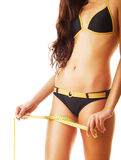 Beautiful slimming woman body in swimsuit with measure Stock Photography