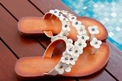 Beautiful slippers poolside Stock Photo