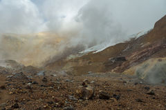 Beautiful slopes Mutnovsky volcano shrouded in clouds. Stock Photo