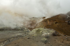 Beautiful slopes Mutnovsky volcano shrouded in clouds. Royalty Free Stock Photos