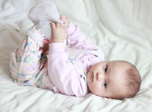 Beautiful small baby girl lying on Royalty Free Stock Photo