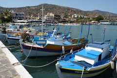 Beautiful small boats of fishermen at the pier. royalty free stock photography