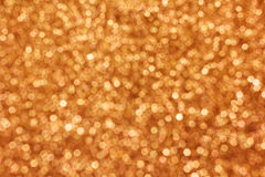 Beautiful small bokeh light sparkle shining on gold and yellow b. Ackground for  abstract luxury glitter Royalty Free Stock Photography