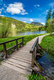 Beautiful small bridge on the lake in the Alps. Germany Royalty Free Stock Photography
