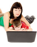 Beautiful a small child with her mother watch the movie the note Stock Photo