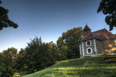 Beautiful small church in the woods Stock Images