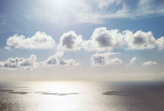 Beautiful small clouds over sea water surface with blue sky royalty free stock photography