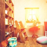Beautiful small cozy room interior with wooden rack, table with royalty free stock photos