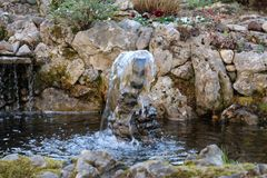 Beautiful Small decorative fountain. This is image of Beautiful Small decorative fountain in Europe royalty free stock images