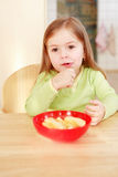 Beautiful small girl eating Royalty Free Stock Photo