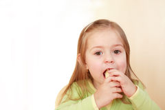 Beautiful small girl eating Royalty Free Stock Photos